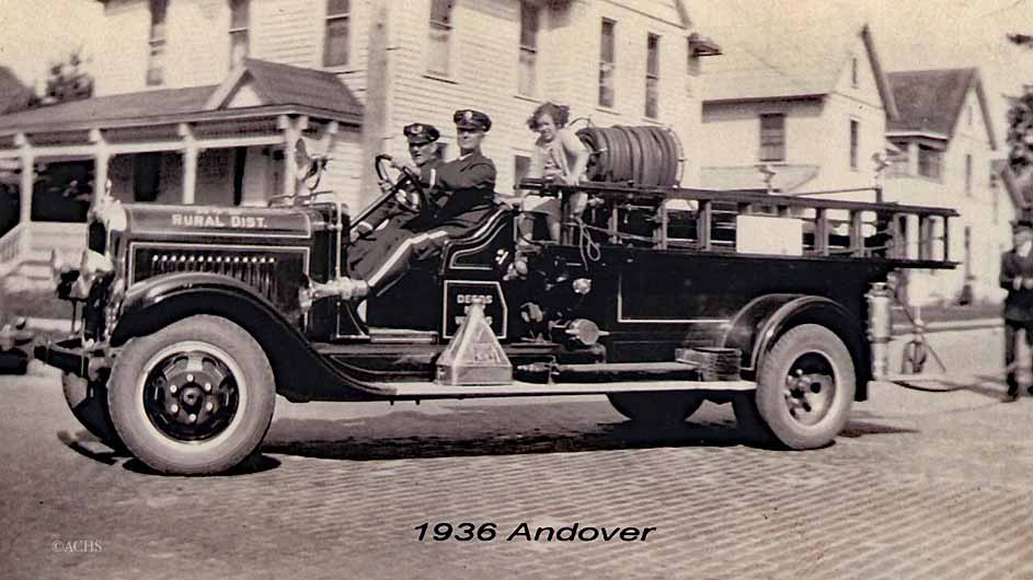 1936, Andover. Archie Kemp driving a 1931 La France GMC pumper, unknown passenger. Little girl was Jean Rogers.